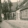 Ulica Ogrodowa w Pasymiu z widokiem na warowny późnogotycki Kościół Zakonu Krzyżackiego z końca XIV w.